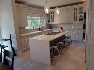 Kitchen island complete with breakfast bar and stools.