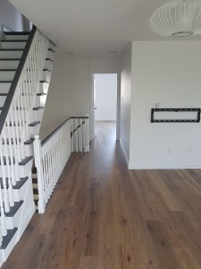 new wood bannister for the stairway leading to the 3rd floor of the home