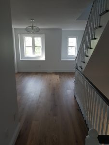 newly renovated home with new hardwood flooring, white trim, new windows and newly painted walls