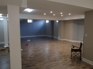 Beautiful hardwood flooring in a basement with updated white trim.