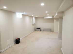 Renovated basement with new carpet, trim, freshly painted walls and new pot lights to brighten the space.