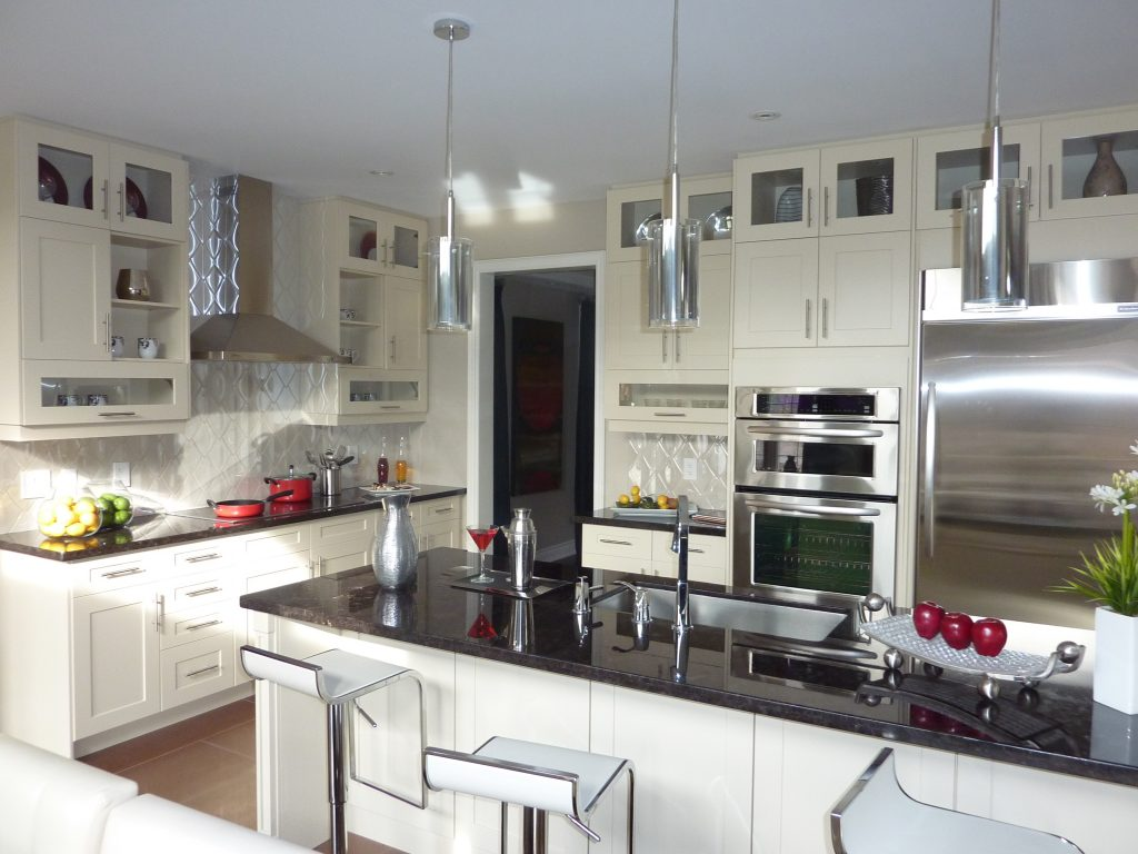 Complete kitchen renovation services to upgrade cupboards, countertops and light fixtures.